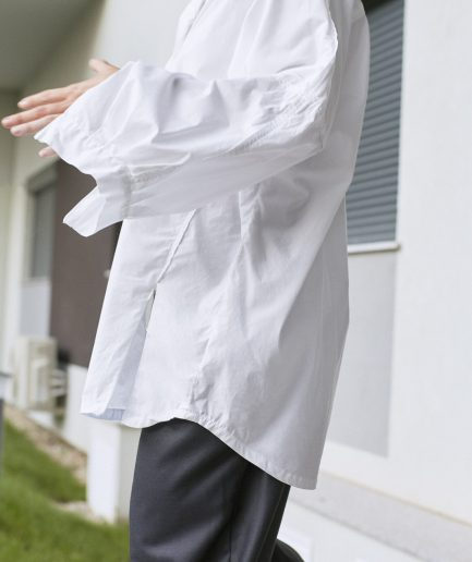 Oversized white cotton shirt with puffed sleeves